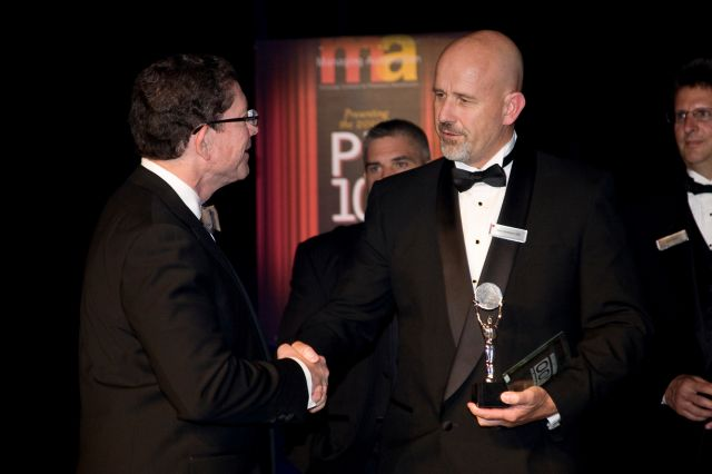 PLI COO Accepts PM100 Award